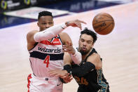 Washington Wizards guard Russell Westbrook (4) passes the ball against Memphis Grizzlies guard Dillon Brooks (24) during the second half of an NBA basketball game, Tuesday, March 2, 2021, in Washington. (AP Photo/Nick Wass)
