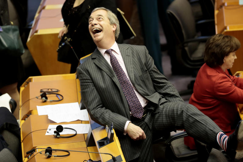 Brexit Party leader Nigel Farage, shows off his Union flag socks ahead of a vote on the UK's withdrawal from the EU during the plenary session at the European Parliament in Brussels, Wednesday, Jan. 29, 2020. The U.K. is due to leave the EU on Friday, Jan. 31, 2020, the first nation in the bloc to do so. (AP Photo/Virginia Mayo)