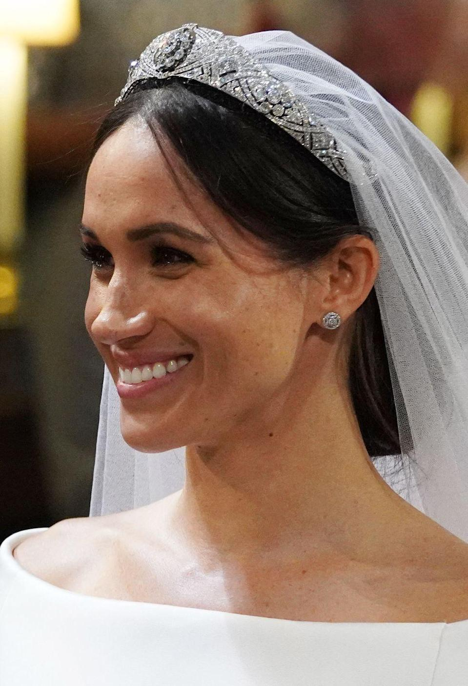 """<p>The <a href=""""https://www.goodhousekeeping.com/beauty/fashion/a19991637/meghan-markle-tiara-royal-wedding/"""" rel=""""nofollow noopener"""" target=""""_blank"""" data-ylk=""""slk:platinum piece"""" class=""""link rapid-noclick-resp"""">platinum piece</a> also belonging to Queen Elizabeth II dates back to 1932, but the circa-1893 center brooch is even older. Eleven sections make up the flexible band, and it's pierced with interlaced ovals and pavé set with large and small brilliant diamonds. The center, detachable brooch itself is set with 10 more diamonds.</p>"""