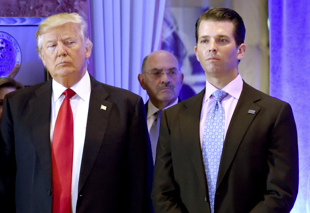 Donald Trump, Allen Weisselberg and Donald Trump Jr. arrive for a press conference at Trump Tower in New York. (Photo by Timothy A. Clary/AFP/Getty Images/File)