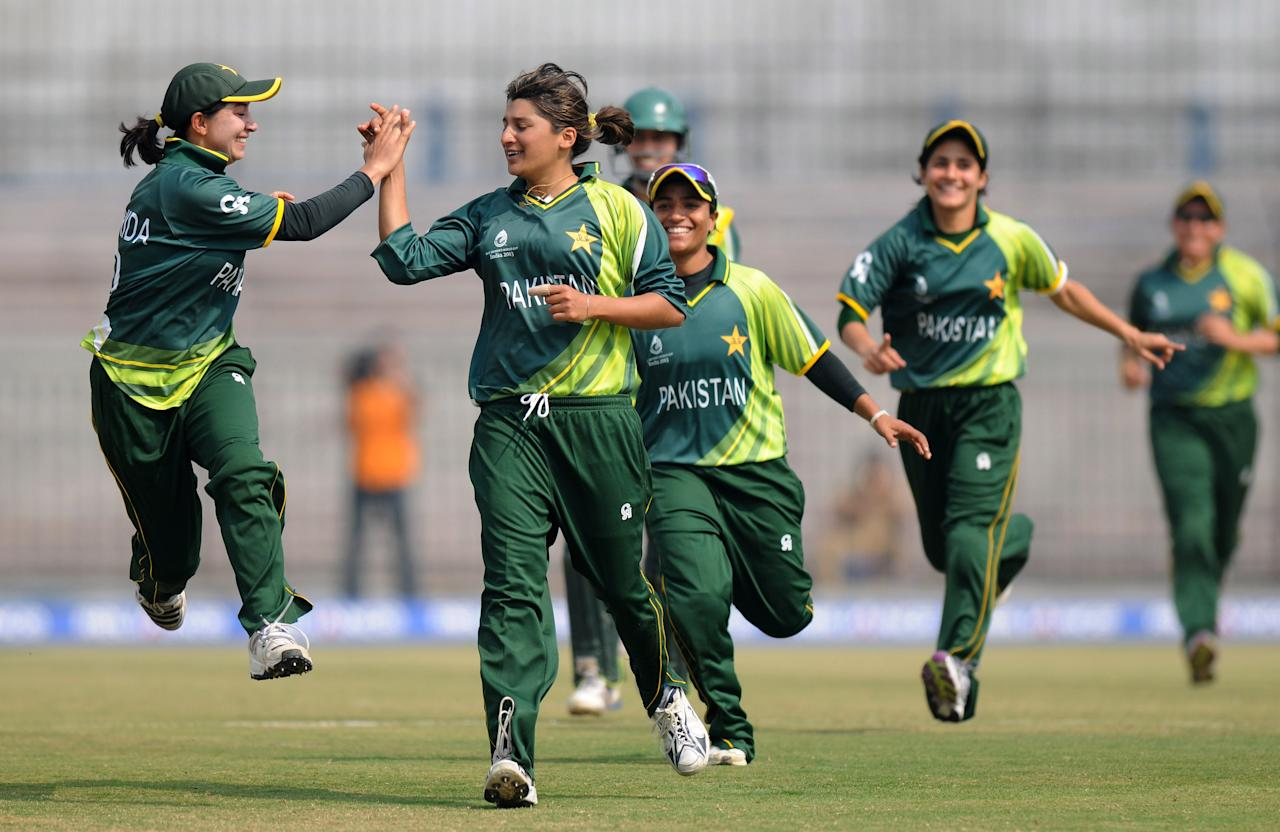 CUTTACK, INDIA - FEBRUARY 01:  Asmavia Iqbal (L) of Pakistan celebrates the wicket of Jodie Fields of Australia with team-mates during the second match of ICC Womens World Cup between Australia and Pakistan, played at the Barabati stadium on February 1, 2013 in Cuttack, India.  (Photo by Pal Pillai-ICC/ICC via Getty Images)