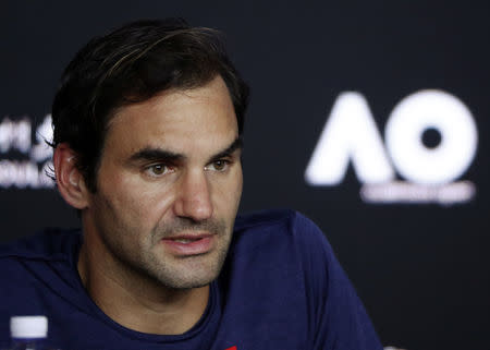 Tennis - Australian Open - Fourth Round - Melbourne Park, Melbourne, Australia, January 20, 2019. Switzerland's Roger Federer speaks duriong a news conference after losing the match against Greece's Stefanos Tsitsipas. REUTERS/Edgar Su