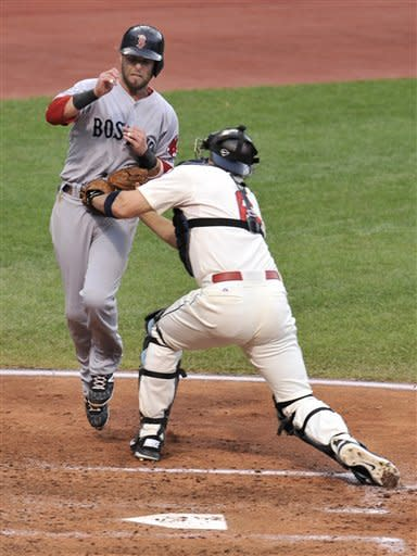 Cleveland Indians catcher Lou Marson, right, tags out Boston Red Sox's Dustin Pedroia, left, who was trying to score on a double by Adrian Gonzalez in the fourth inning of a baseball game on Saturday, Aug. 11, 2012, in Cleveland. (AP Photo/David Richard)