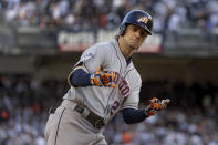Houston Astros' Josh Reddick (22) reacts after hitting a solo home run against the New York Yankees during the second inning of Game 3 of baseball's American League Championship Series, Tuesday, Oct. 15, 2019, in New York. (AP Photo/Frank Franklin II)