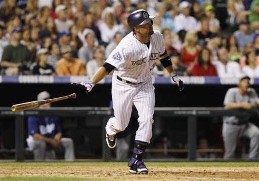 Colorado Rockies' Michael Cuddyer follows the flight of his solo home run against the Los Angeles Dodgers in the seventh inning of a 9-5 victory in a baseball game in Denver, Thursday, July 4, 2013. (AP Photo/David Zalubowski)