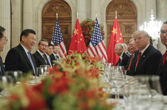 FILE - In this Dec. 1, 2018, file photo, President Donald Trump, second from right, meets with China's President Xi Jinping, second from left, during their bilateral meeting at the G20 Summit, in Buenos Aires, Argentina. Tensions between the world's two biggest economies intensified over the last week. The Trump administration more than doubled tariffs on $200 billion in Chinese imports and spelled out plans to target the $300 billion worth that aren't already facing 25% taxes. The Chinese have punched back by upping tariffs on $60 billion in U.S. imports. (AP Photo/Pablo Martinez Monsivais, File)