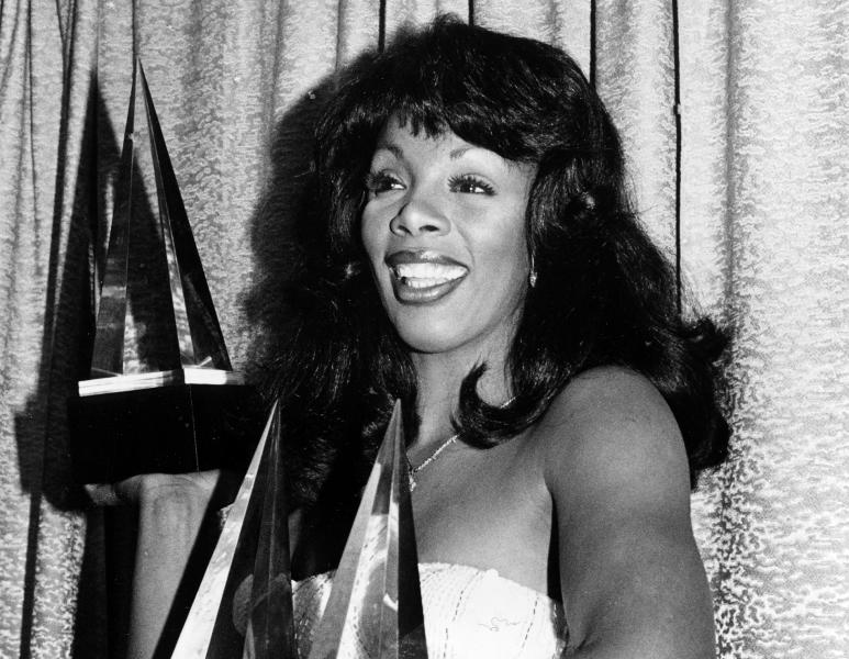 FILE - In this Jan. 12, 1979 file photo, singer Donna Summer poses with three awards she won at the American Music Awards in Los Angeles, Calif. Summer, the Queen of Disco who ruled the dance floors with anthems like ìLast Dance,î ìLove to Love You Babyî and ìBad Girl,î has died. Her family announced her death in a statement Thursday, May 17, 2012. She was 63. (AP Photo/Nick Ut, File)