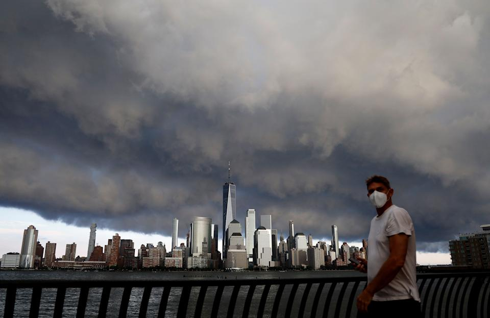 A thunderstorm passes over the skyline of lower Manhattan. (Photo: Gary Hershorn via Getty Images)