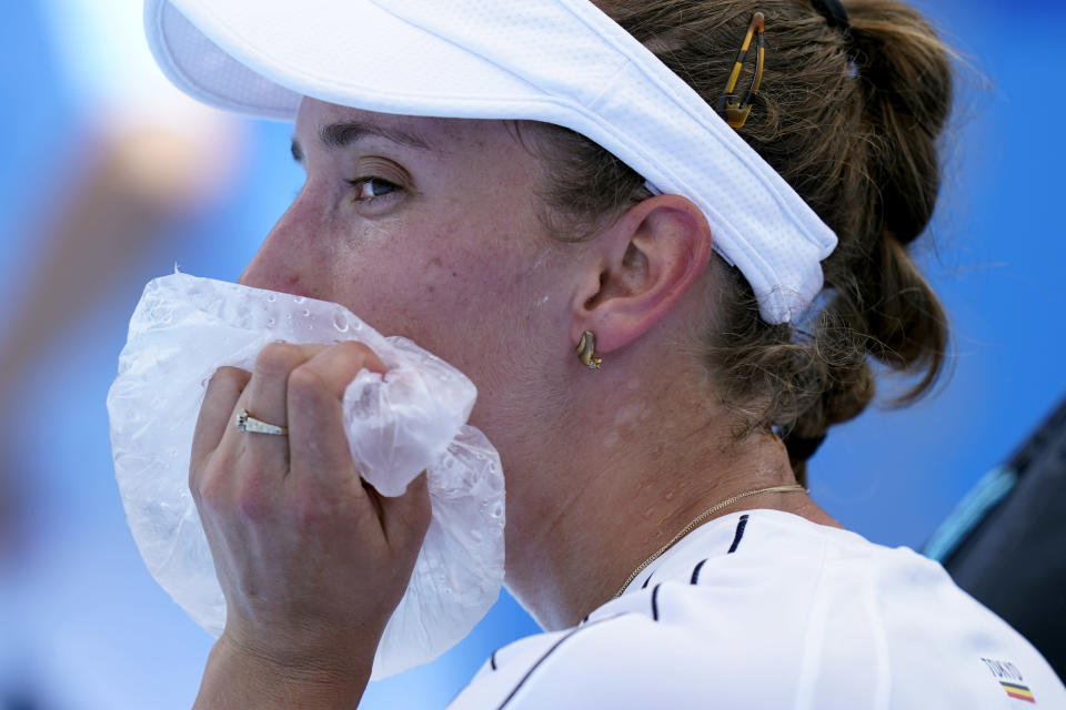 Elise Mertens, of Belgium, uses a bag of ice to cool off during a tennis†match against Ekaterina Aleksandrova, of the Russian Olympic Committee, at the 2020 Summer Olympics, Sunday, July 25, 2021, in Tokyo, Japan. (AP Photo/Patrick Semansky)