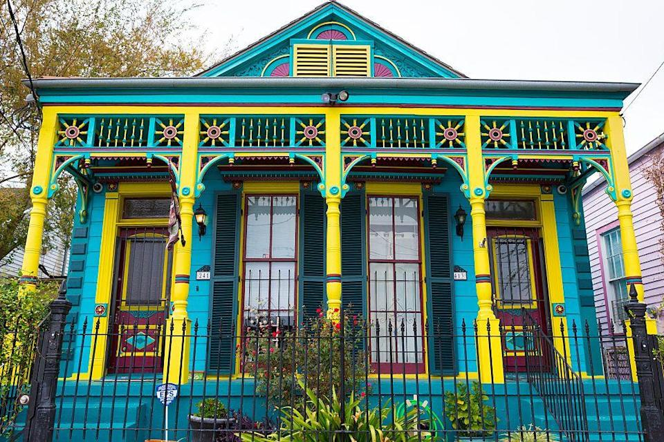 <p>A medley of vibrant shades highlight the Victorian architecture of this Louisiana home.</p>