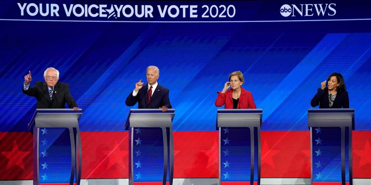 FILE PHOTO: Senator Bernie Sanders, former Vice President Joe Biden, Senator Elizabeth Warren and Senator Kamala Harris (L-R) participate in the 2020 Democratic U.S. presidential debate in Houston, Texas, U.S. September 12, 2019. REUTERS/Mike Blake/File Photo