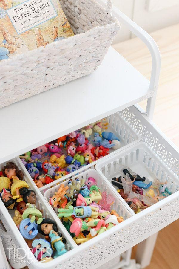 """<p>Keep drawers sorted with compartment organizers for smaller toys like dolls, Legos, and craft supplies.</p><p><strong>See more at <a href=""""https://www.tidbits-cami.com/girls-shared-bedroom-refresh/"""" rel=""""nofollow noopener"""" target=""""_blank"""" data-ylk=""""slk:Tidbits-Cami"""" class=""""link rapid-noclick-resp"""">Tidbits-Cami</a>.</strong></p><p><strong><strong><strong><a class=""""link rapid-noclick-resp"""" href=""""https://www.amazon.com/s?k=plastic+storage+bins&ref=nb_sb_noss_2&tag=syn-yahoo-20&ascsubtag=%5Bartid%7C10063.g.36014277%5Bsrc%7Cyahoo-us"""" rel=""""nofollow noopener"""" target=""""_blank"""" data-ylk=""""slk:SHOP PLASTIC STORAGE BINS"""">SHOP PLASTIC STORAGE BINS</a></strong></strong><br></strong></p>"""