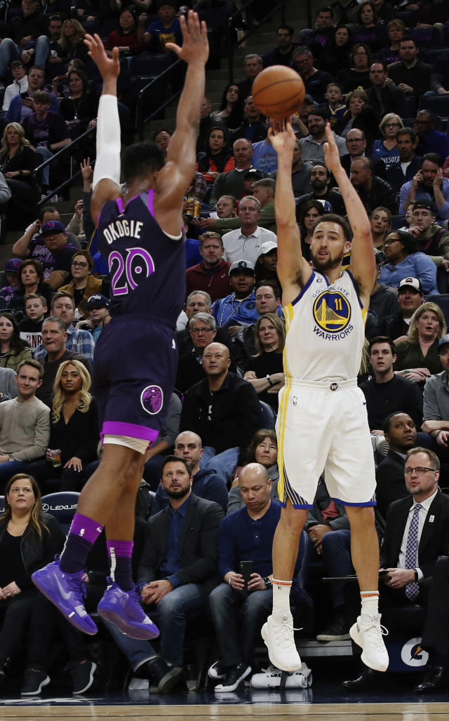 Golden State Warriors' Klay Thompson, right, shoots over Minnesota Timberwolves' Josh Okogie in the second half of an NBA basketball game Tuesday, March 19, 2019, in Minneapolis. The Warriors won 117-107. Thompson scored 28 points. (AP Photo/Jim Mone)
