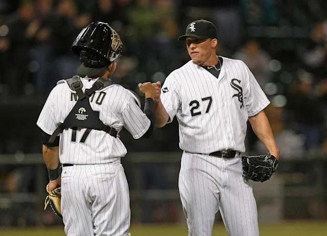 CHICAGO, IL - APRIL 10: Matt Lindstrom #27 of the Chicago White Sox celebrates a win with Adrian Nieto #17 over the Cleveland Indians at U.S. Cellular Field on April 10, 2014 in Chicago, Illinois. The White Sox defeated the Indians 7-3. (Photo by Jonathan Daniel/Getty Images)