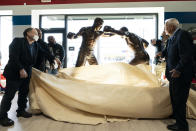 A statue of boxers Joe Frazier, center right, and Muhammad Ali, center left, is unveiled on the 50th anniversary their World Heavyweight Champion fight, at the Joe Hand Gym in Feasterville, Pa., Monday, March 8, 2021. (AP Photo/Matt Rourke)