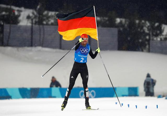 Nordic Combined Events - Pyeongchang 2018 Winter Olympics - Men's Team 4 x 5 km Final - Alpensia Cross-Country Skiing Centre - Pyeongchang, South Korea - February 22, 2018 - Johannes Rydzek of Germany waves the German flag as he crosses the finish line. REUTERS/Kai Pfaffenbach TPX IMAGES OF THE DAY