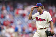 Philadelphia Phillies' Aaron Nola tips his cap to the fans as he heads off the field during the ninth inning of a baseball game against the Atlanta Braves, Sunday, July 25, 2021, in Philadelphia. (AP Photo/Chris Szagola)