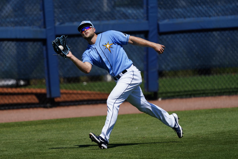 Tampa Bay Rays left fielder Austin Meadows (17) makes a running catch on a fly ball hit by Minnesota Twins' Luis Arraez in the third inning of a spring training baseball game Saturday, March 13, 2021, in Port Charlotte, Fla.. (AP Photo/John Bazemore)