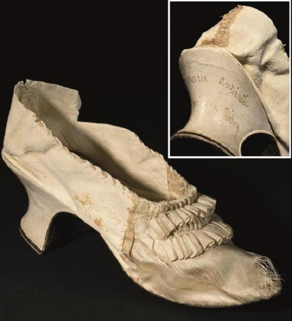 An elegant white shoe made of silk and goat leather that belonged to Marie-Antoinette, France's last queen before the 1789 revolution, goes up for auction on Sunday.