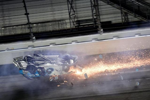 Ryan Newman's car skids on its roof after a last-lap crash at the Daytona 500 (AFP Photo/Jared C. Tilton)
