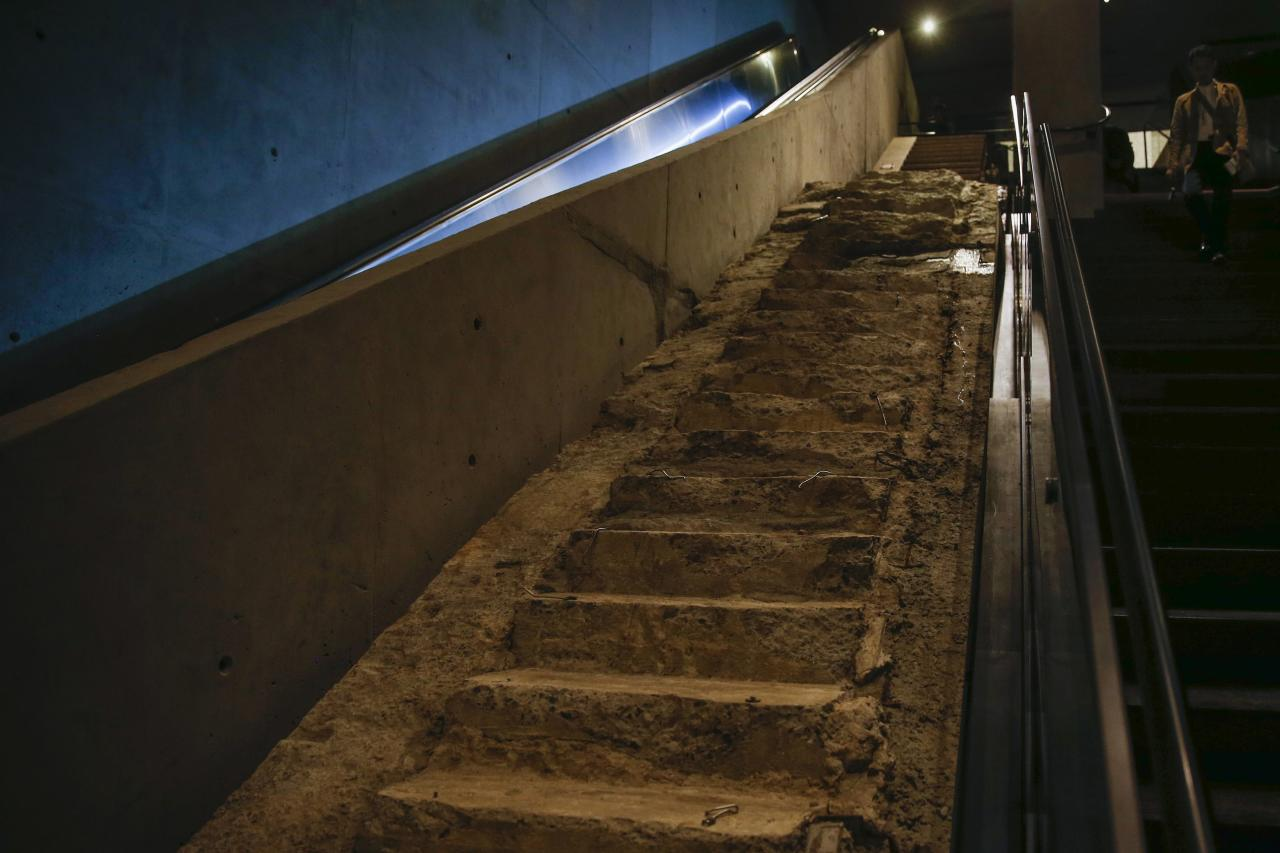 The 'Survivors' Stairs' are seen in the National September 11 Memorial & Museum during a media preview in New York May 14, 2014. A museum commemorating the Sept. 11, 2001 attacks on New York and Washington is on the verge of opening, with wrenchingly familiar sights as well as artifacts never before on public display. Among the first visitors to the National September 11 Memorial Museum are victims' family members and others intimately involved in its creation who will attend on Thursday, after a Wednesday media preview. The doors open to the general public on May 21. REUTERS/Shannon Stapleton (UNITED STATES - Tags: DISASTER SOCIETY)