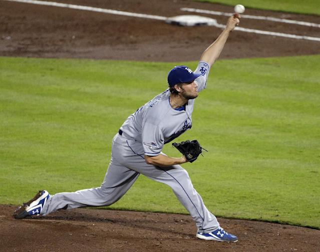 Los Angeles Dodgers starting pitcher Clayton Kershaw works against the Atlanta Braves in the second inning of Game 1 of the National League Divisional Series, Thursday, Oct. 3, 2013, in Atlanta. (AP Photo/David Goldman)