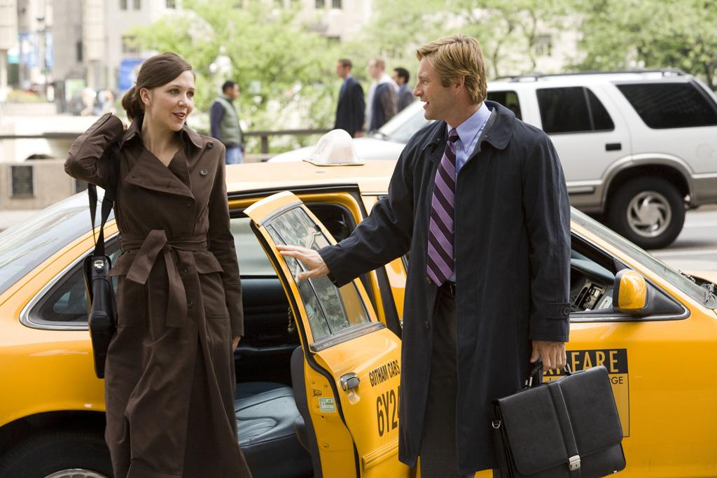 """<a href=""""http://movies.yahoo.com/movie/contributor/1800360995"""">Maggie Gyllenhaal</a> as Rachel Dawes and <a href=""""http://movies.yahoo.com/movie/contributor/1800022565"""">Aaron Eckhart</a> as Harvey Dent in Warner Bros. Pictures' <a href=""""http://movies.yahoo.com/movie/1809271891/info"""">The Dark Knight</a> - 2008"""