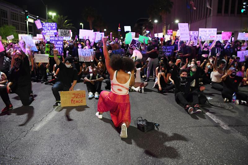 Protesters attend a demonstration demanding justice for the death of George Floyd on May 30, 2020 in Las Vegas.