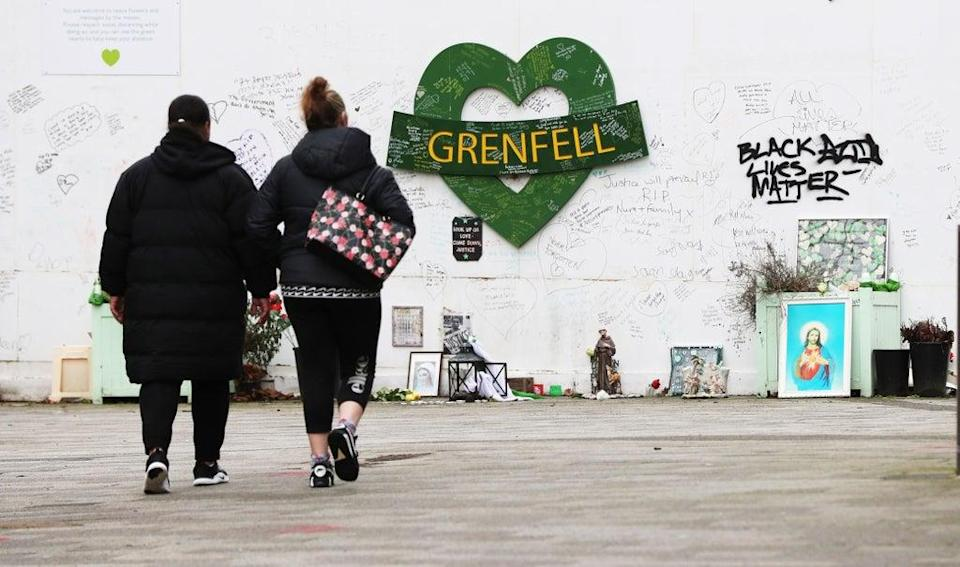 Two women are seen approaching a tribute to the Grenfell Tower fire. File image. (Jonathan Brady/PA) (PA Archive)