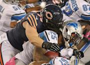 CHICAGO, IL - OCTOBER 22: Mikel Leshoure #25 of the Detroit Lions is tackled by Shea McClellin #99 of the Chicago Bears at Soldier Field on October 22, 2012 in Chicago, Illinois. (Photo by Jonathan Daniel/Getty Images)