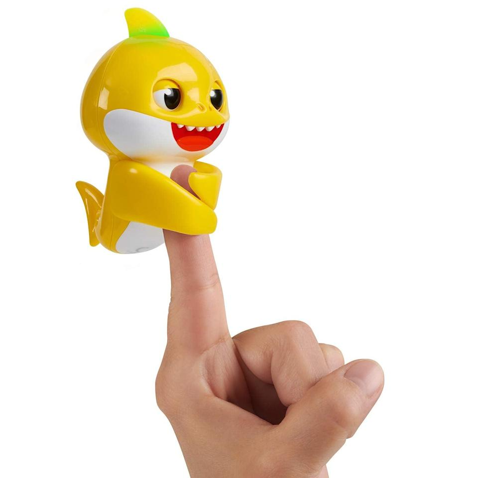 """<p>These <a href=""""https://www.popsugar.com/buy/Pinkfong-Baby-Shark-Fingerlings-585249?p_name=Pinkfong%20Baby%20Shark%20Fingerlings&retailer=amazon.com&pid=585249&price=17&evar1=moms%3Aus&evar9=45808433&evar98=https%3A%2F%2Fwww.popsugar.com%2Fphoto-gallery%2F45808433%2Fimage%2F45808441%2FAdd-Fingerlings-Collection&list1=toy%20fair%2Ckid%20shopping&prop13=api&pdata=1"""" class=""""link rapid-noclick-resp"""" rel=""""nofollow noopener"""" target=""""_blank"""" data-ylk=""""slk:Pinkfong Baby Shark Fingerlings"""">Pinkfong Baby Shark Fingerlings</a> ($17) wrap around your finger, give kisses, and sing, of course! They make perfect gifts for toddlers over the age of 5!</p>"""
