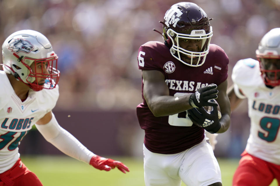 Texas A&M running back Devon Achane (6) runs past New Mexico linebacker Ray Leutele (30) for a touchdown during the first quarter of an NCAA college football game on Saturday, Sept. 18, 2021, in College Station, Texas. (AP Photo/Sam Craft)