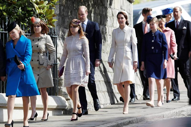 Royals: They were joined by Princesses Eugenie (second left) and Beatrice (third left) along with other members of the Royal family (PA)