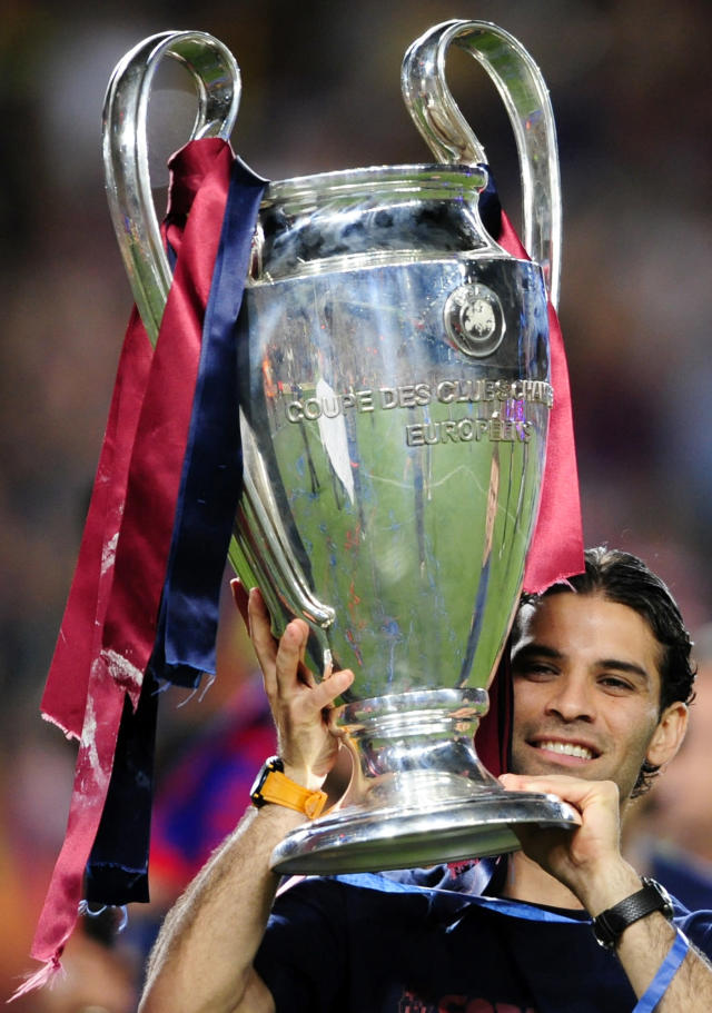 FC Barcelona's Rafael Marquez, from Mexico, holds the Champions League trophy at the Camp Nou Stadium in Barcelona, Spain, Thursday, May 28, 2009. Barcelona beat Manchester United 2-0 during the final soccer match of the Champions League held in Rome. (AP Photo/Manu Fernandez)
