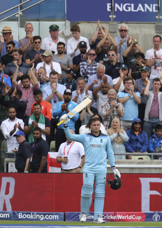England's batsman Jason Roy raises his bat as he acknowledges applause from supporters after being dismissal for 85 runs during the Cricket World Cup semi-final match between Australia and England at Edgbaston in Birmingham, England, Thursday, July 11, 2019. (AP Photo/Rui Vieira)