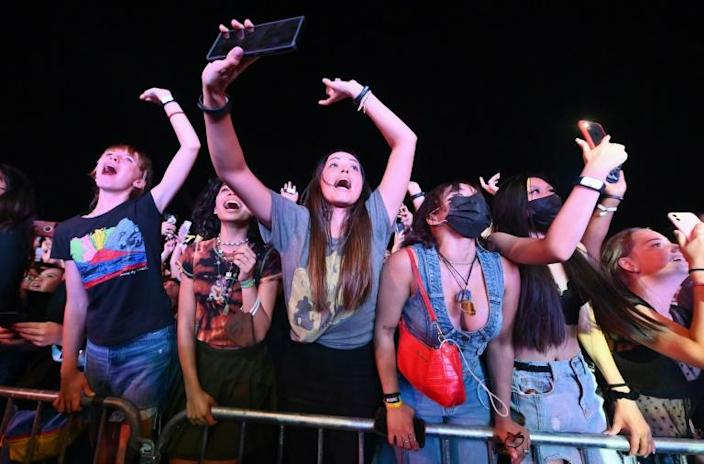 People cheer as Coldplay perform during the 2021 Global Citizen Live festival at the Great Lawn, Central Park on September 25, 2021 in New York City (AFP/Angela Weiss)