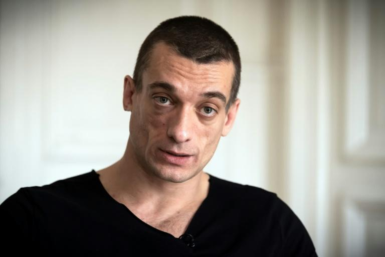 Russian artist Pyotr Pavlensky speaks during a press interview with AFP at his lawyer's office in Paris on February 14, 2020.Pavlensky was placed in custody on February 15, 2020 as part of an investigation for violence on December 31, 2019. Emmanuel Macron's candidate for Paris mayor, Benjamin Griveaux, withdrew from the race over a leaked sex video on February 13, in a blow for the French president's party ahead of March local elections. Griveaux said he opted for retreat to protect his family after a website published video excerpts of a man masturbating, accompanied by screengrabs of racy text messages, which it said came from the former government spokesman. On February 14, the Russian performance artist Pyotr Pavlensky confirmed, in an AFP interview in the office of his lawyer Juan Branco, that he was responsible for publishing the video online