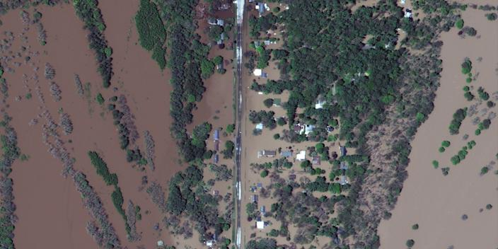 A satellite image shows the flooded Isabella Street and homes after rising flood waters unleashed by two dam failures submerged parts of Midland, Michigan, U.S. May 20, 2020
