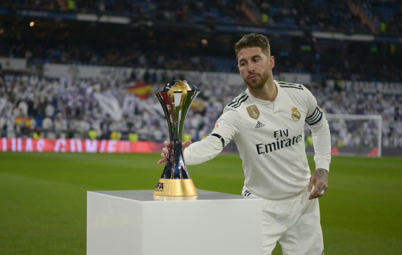 Sergio Ramos picks up the FIFA Club World Cup won by Real Madrid to present his fans at the Santiago Bernabeu Stadium on January 6, 2018 in Madrid, Spain. (Photo by Patricio Realpe/ChakanaNews/NurPhoto via Getty Images)