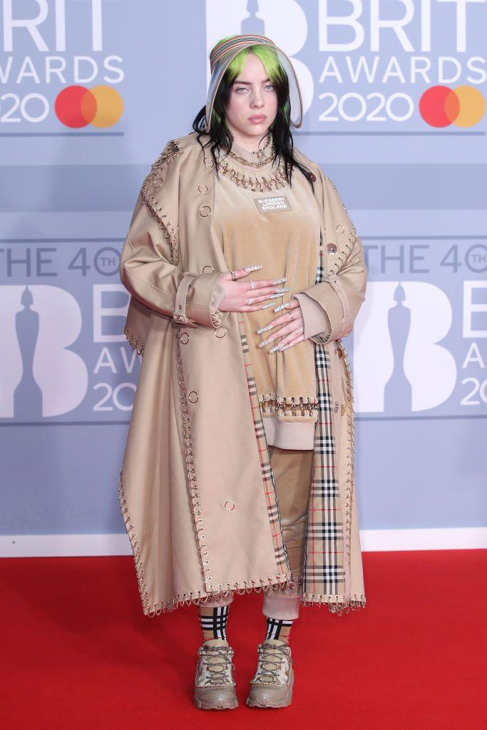 <p>The 2020 Brit award winner arrived on the red carpet paying homage to British fashion, wearing head-to-toe custom Burberry.</p>