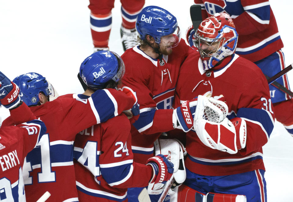 Montreal Canadiens' Eric Staal (21) celebrates the team's win with goaltender Carey Price following overtime in Game 6 of an NHL hockey Stanley Cup semifinal playoff series against the Vegas Golden Knights Thursday, June 24, 2021 in Montreal. (Paul Chiasson/The Canadian Press via AP)