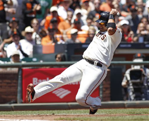 San Francisco Giants' Guillermo Quiroz slides safely into home during the third inning of a baseball game against the Los Angeles Dodgers in San Francisco, Sunday, July 7, 2013. (AP Photo/George Nikitin)