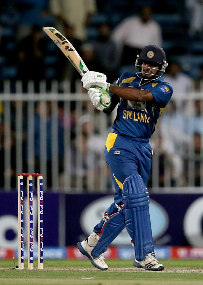 SHARJAH, UNITED ARAB EMIRATES - DECEMBER 18:  Kusal Janith Perera of Sri Lanka bats during the first One-Day International (ODI ) match between Sri Lanka and Pakistan at the Sharjah Cricket Stadium on December 18, 2013 in Sharjah, United Arab Emirates.  (Photo by Francois Nel/Getty Images)
