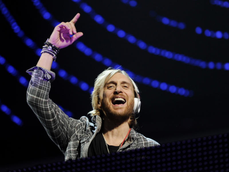 """FILE - In this Dec. 9, 2011 file photo, DJ David Guetta performs at Z100's Jingle Ball concert at Madison Square Garden in New York. Guetta can't wait for you to hear his new song """"One Voice"""" for a couple of reasons. The song is at the heart of a new partnership with the United Nations and the 46-year-old French producer and DJ hopes it will inspire fans to donate money for humanitarian relief around the world, simply by tweeting. And he wants you to hear a brand new side of his musical personality.(AP Photo/Evan Agostini, file)"""