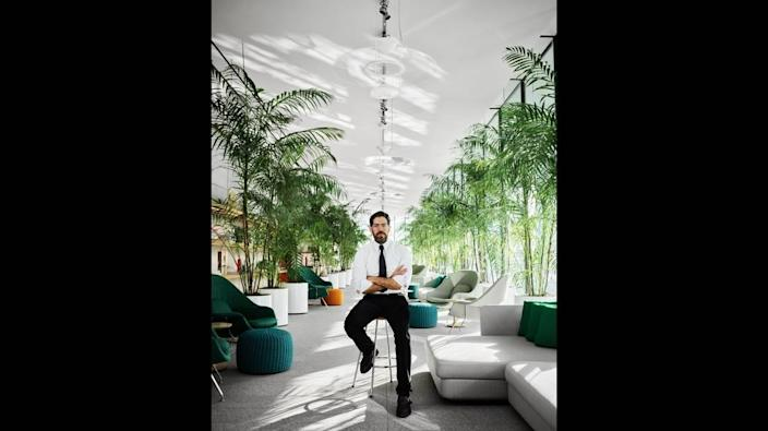 Terra CEO David Martin sits inside the lobby of the Eighty Seven Park luxury condo in North Beach, FL.