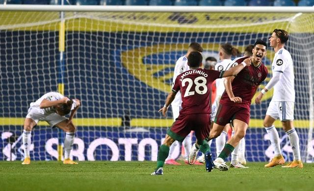 Raul Jimenez, right, celebrates after his shot was deflected in for the winner