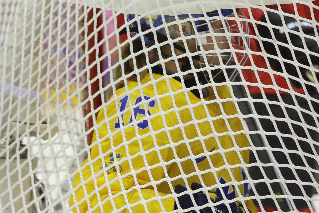 Pernilla Winberg of Sweden (16) is shoved into the net during the second period of the women's bronze medal ice hockey game against Switzerland at the 2014 Winter Olympics, Thursday, Feb. 20, 2014, in Sochi, Russia. (AP Photo/Matt Slocum)