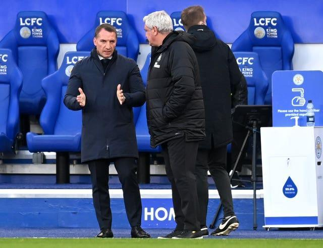 Brendan Rodgers, left, and Steve Bruce in conversation during Friday night's game