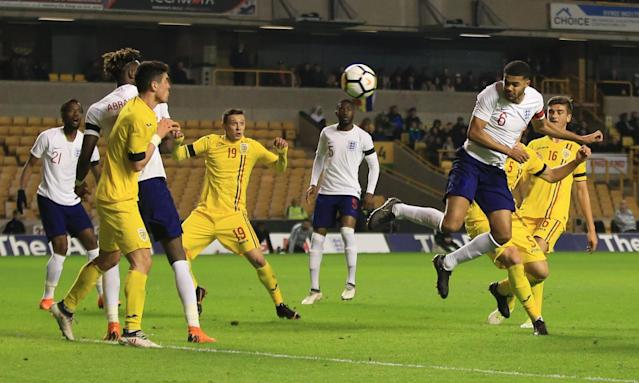 Jake Clarke-Salter heads in what proved to be England's winner against Romania in the two sides' friendly game at Molineux.