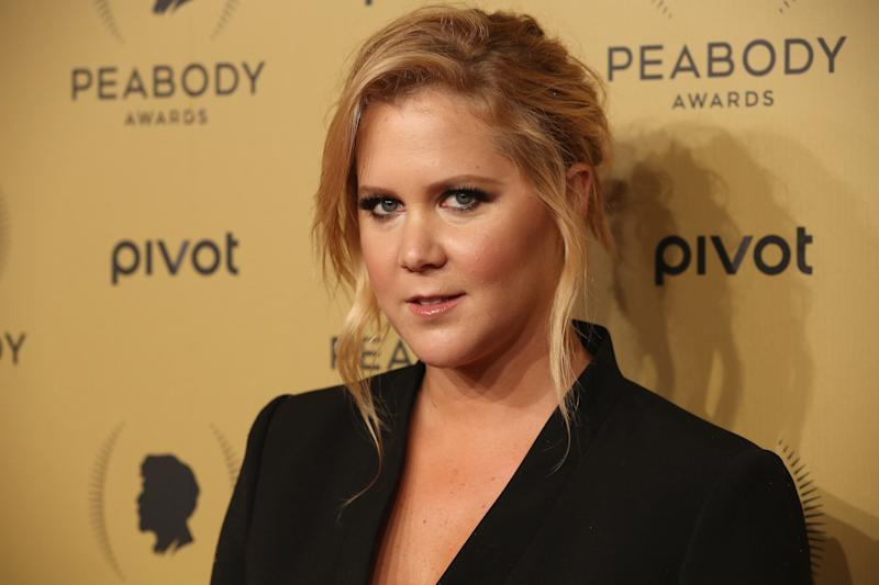 Amy Schumer at the Peabody Awards wearing a black dress